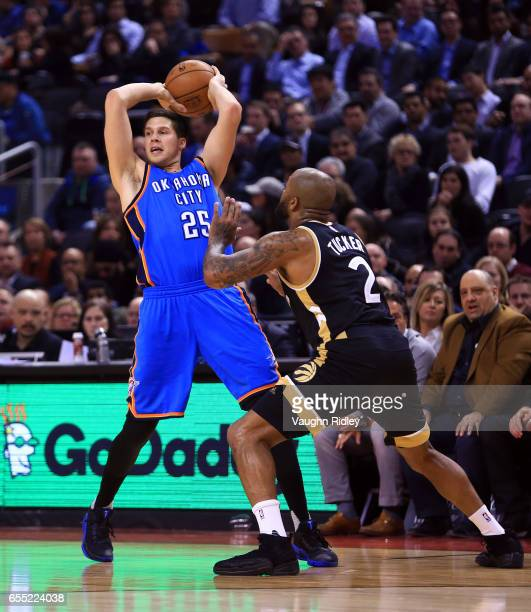 Doug McDermott of the Oklahoma City Thunder passes the ball as PJ Tucker of the Toronto Raptors defends during the first half of an NBA game at Air...