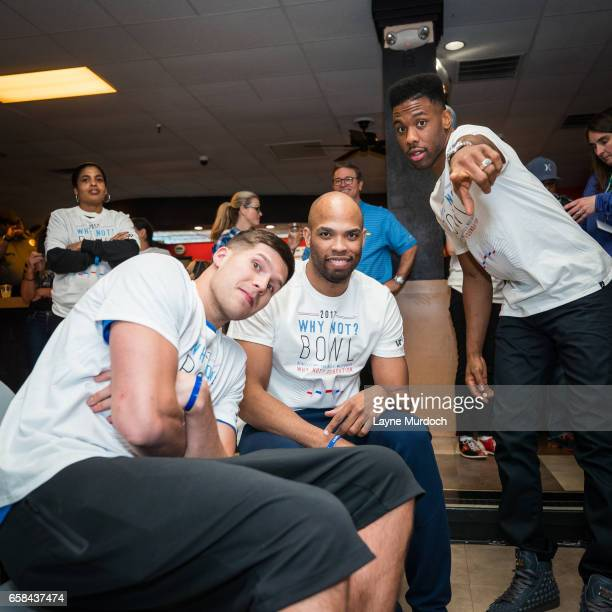 Doug McDermott Taj Gibson and Norris Cole of the Oklahoma City Thunder pose for a photo during Russell Westbrook's 7th annual Why Not Foundation...