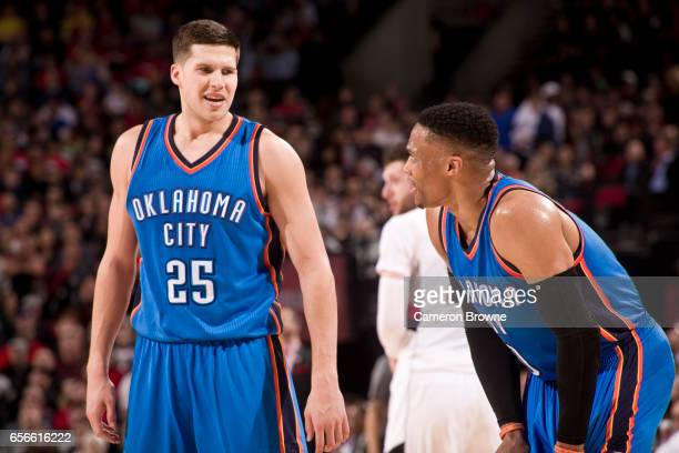 Doug McDermott talks with Russell Westbrook of the Oklahoma City Thunder during the game against the Portland Trail Blazers on March 2 2017 at the...