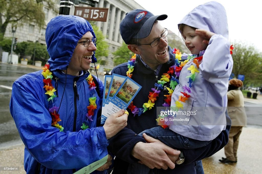 Doug Metcalfe and his partner Brian Lahmann show their White House Easter Egg Roll event tickets to their daughter Helen LahmannMetcalfe after...