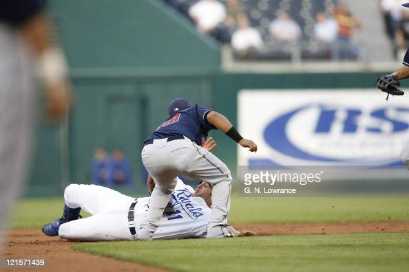 Doug Mientkiewicz of Kansas City is thrown out after being caught in a rundown during action between the Cleveland Indians and Kansas City Royals at...