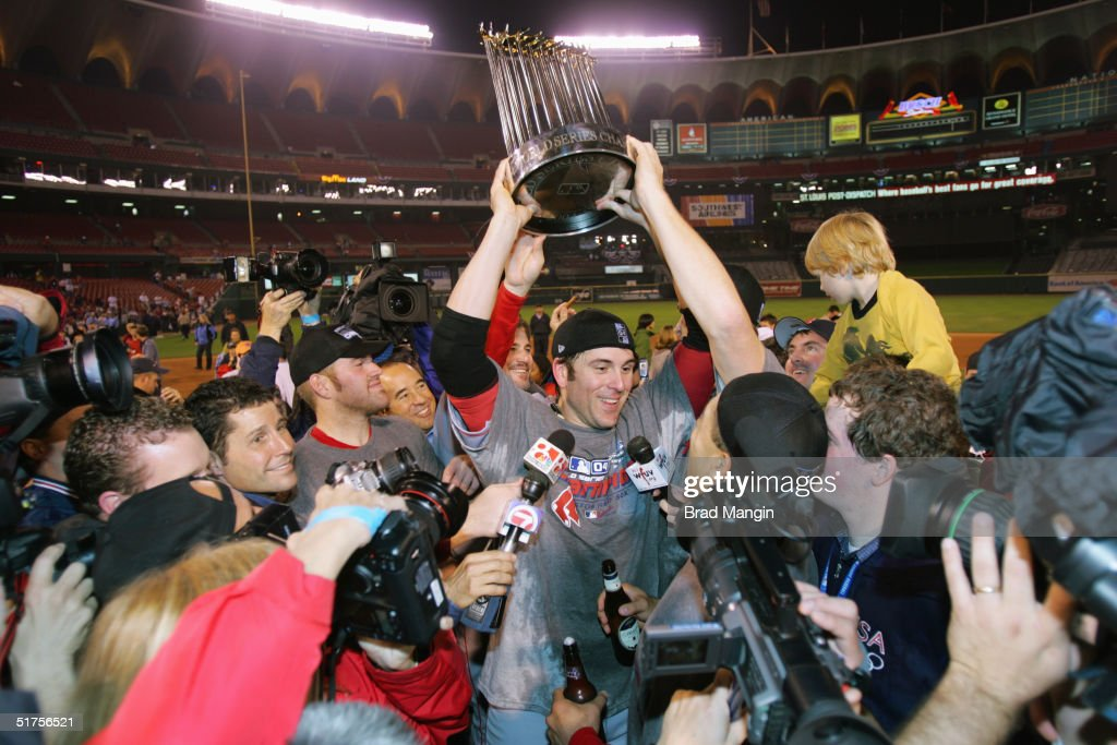 Doug Mientkiewicz of the Boston Red Sox celebrates after winning game four of the 2004 World Series against the St Louis Cardinals at Busch Stadium...