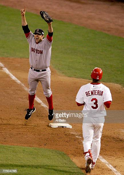 Doug Mientkiewicz of the Boston Red Sox celebrates the final out and defeating the St Louis Cardinals 30 in game four of the World Series on October...