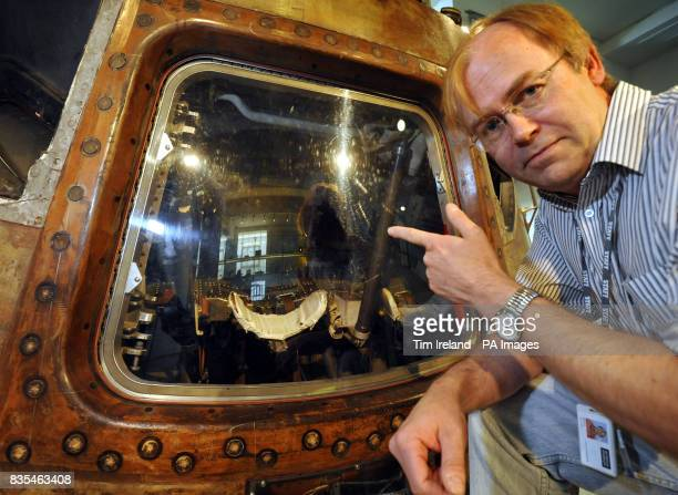 Doug Millard senior space curator of the Science Museum in London looks inside the Apollo 10 command module through the perspex cover which will be...