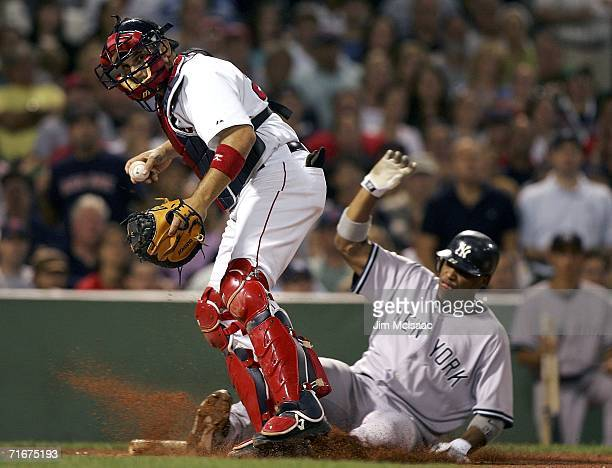 Doug Mirabelli of the Boston Red Sox forces out at home Robinson Cano of the New York Yankees at Fenway Park August 18 2006 in Boston Massachusetts