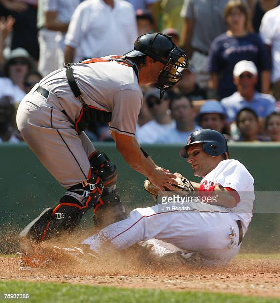 Doug Mirabelli of the Boston Red Sox is tagged out by catcher Paul Bako of the Baltimore Orioles on August 2 2007 at Fenway Park in Boston...