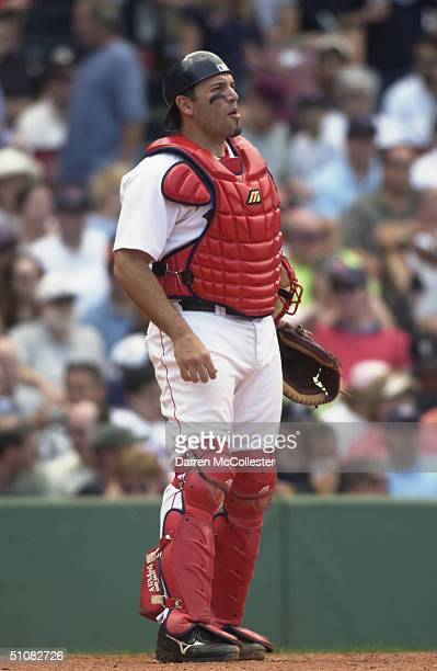 Doug Mirabelli of the Boston Red Sox looks on during the game against the Minnesota Twins on June 24 2004 at Fenway Park in Boston Massachusetts The...