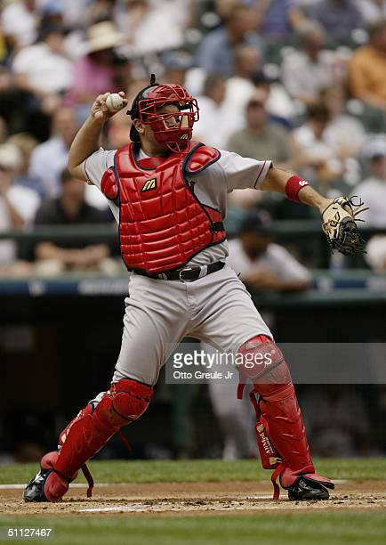 Doug Mirabelli of the Boston Red Sox makes a throw during the game against the Seattle Mariners on July 20 2004 at Safeco Field in Seattle Washington...