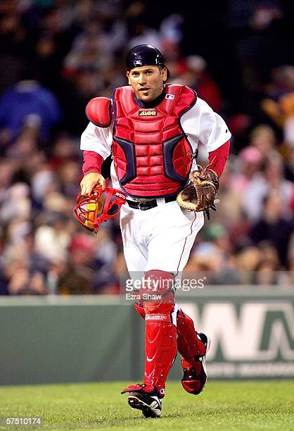 Doug Mirabelli of the Boston Red Sox runs back to the dugout after the second inning during their game against the New York Yankees at Fenway Park on...