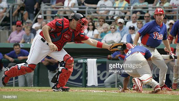Doug Mirabelli of the Boston Red Sox tags out Abraham Nunez of the Philadelphia Phillies during a Spring Training game at City of Palms Park March 3...