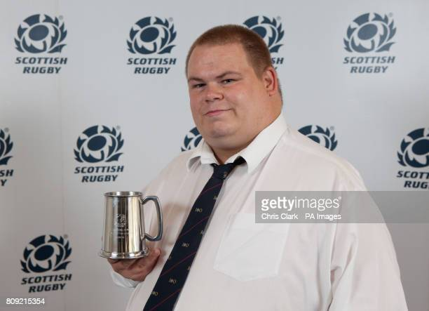 Doug Murray from Lismore RFC with the East Regional Leagues Player of the Season award which he collected on behalf of winner John Grant during the...