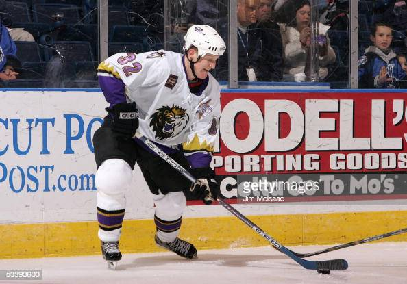Doug Nolan of the Manchester Monarchs skates with the puck during a American Hockey League game against the Bridgeport Sound Tigers at the Arena at...