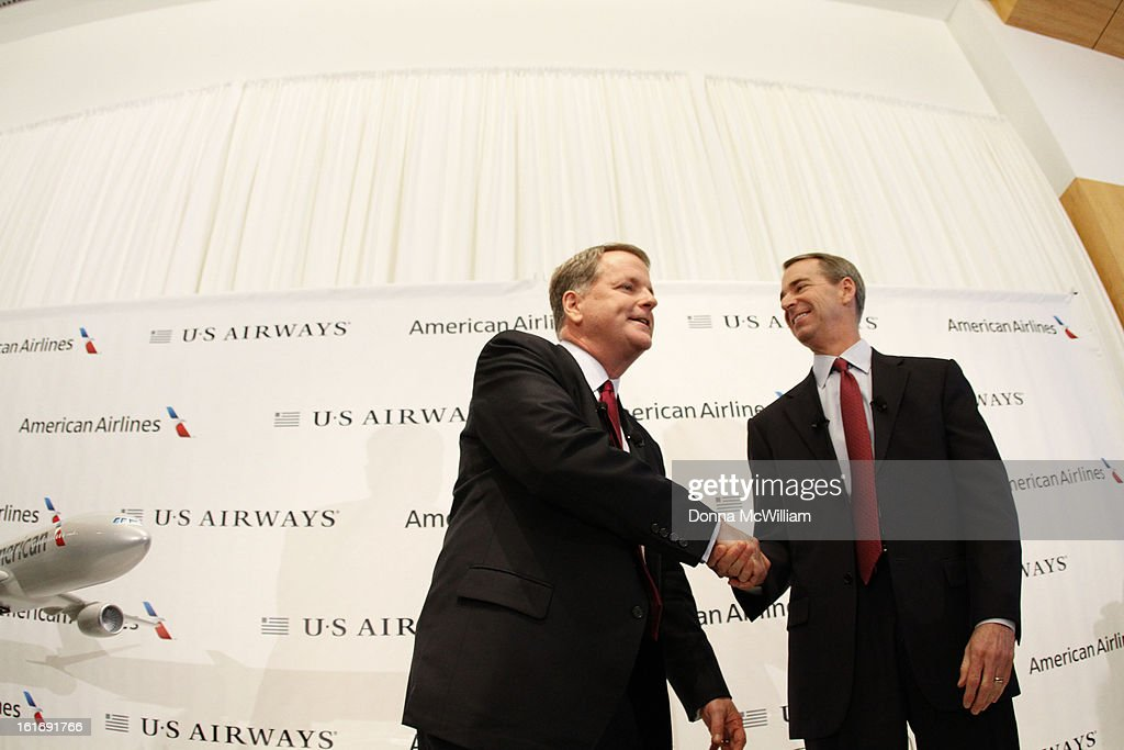 Doug Parker (L), Chairman and CEO of US Airways, and Thomas Horton, Chairman, President and Chief Executive Officer of American Airlines shake hands after a news conference to announce the merger of the two airlines February 14, 2013 in Dallas Texas. US Airways and American Airlines have agreed to an $11 billion merger, creating the largest airline in the world. The airline will be called American Airlines and be headed by US Airways CEO Doug Parker. (Photo by Donna McWilliam/Getty Images