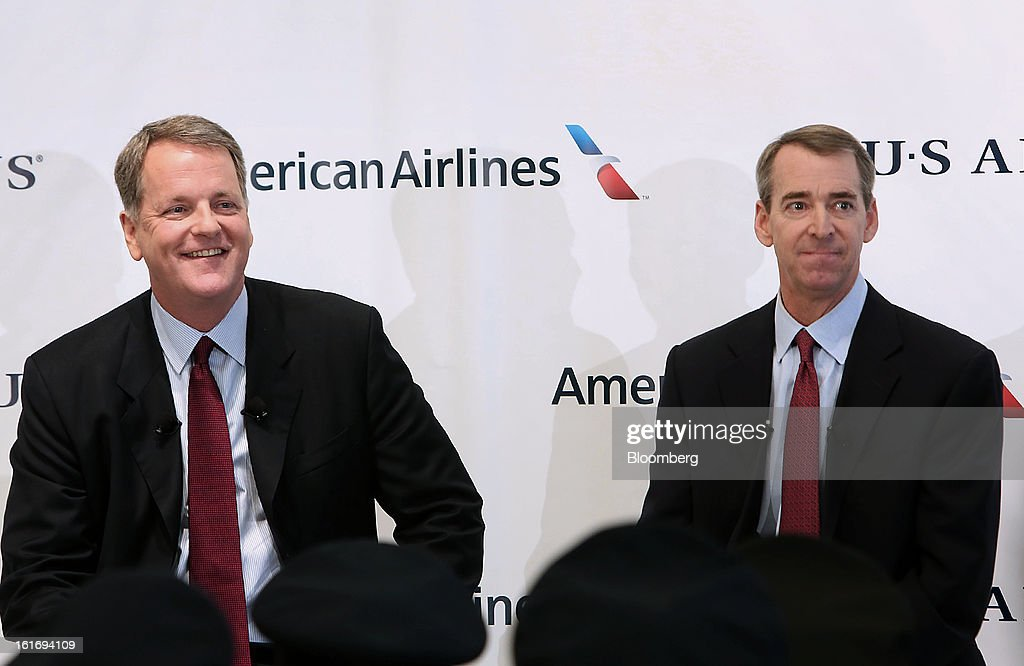 Doug Parker, chief executive officer of US Airways Group Inc., left, and Tom Horton, president and chief executive officer of AMR Corp.'s American Airlines, listen to a question during a press conference at Dallas Fort Worth Airport in Fort Worth, Texas, U.S., on Thursday, Feb. 14, 2013. US Airways Group Inc., spurned in three prior merger attempts, will combine with bankrupt AMR Corp.'s American Airlines in an $11 billion all-stock deal to create the world's largest carrier. Photographer: Mike Fuentes/Bloomberg via Getty Images