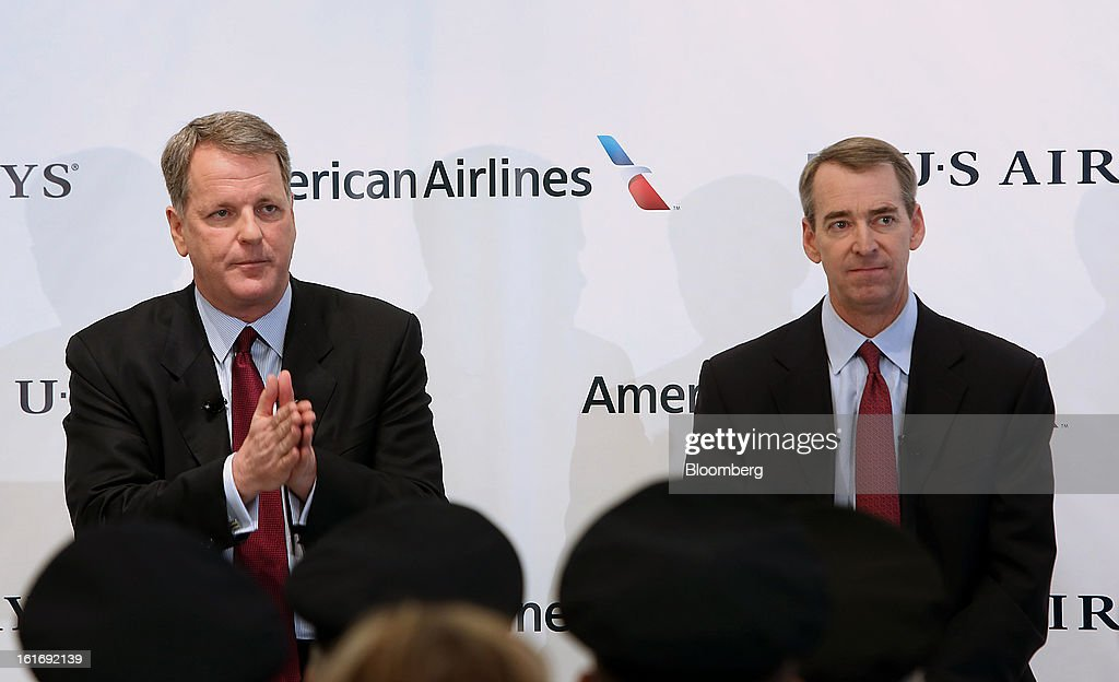 Doug Parker, chief executive officer of US Airways Group Inc., left, speaks while Tom Horton, president and chief executive officer of AMR Corp.'s American Airlines, listens during a press conference at Dallas Fort Worth Airport in Fort Worth, Texas,U.S., on Thursday, Feb. 14, 2013. US Airways Group Inc., spurned in three prior merger attempts, will combine with bankrupt AMR Corp.'s American Airlines in an $11 billion all-stock deal to create the world's largest carrier. Photographer: Mike Fuentes/Bloomberg via Getty Images
