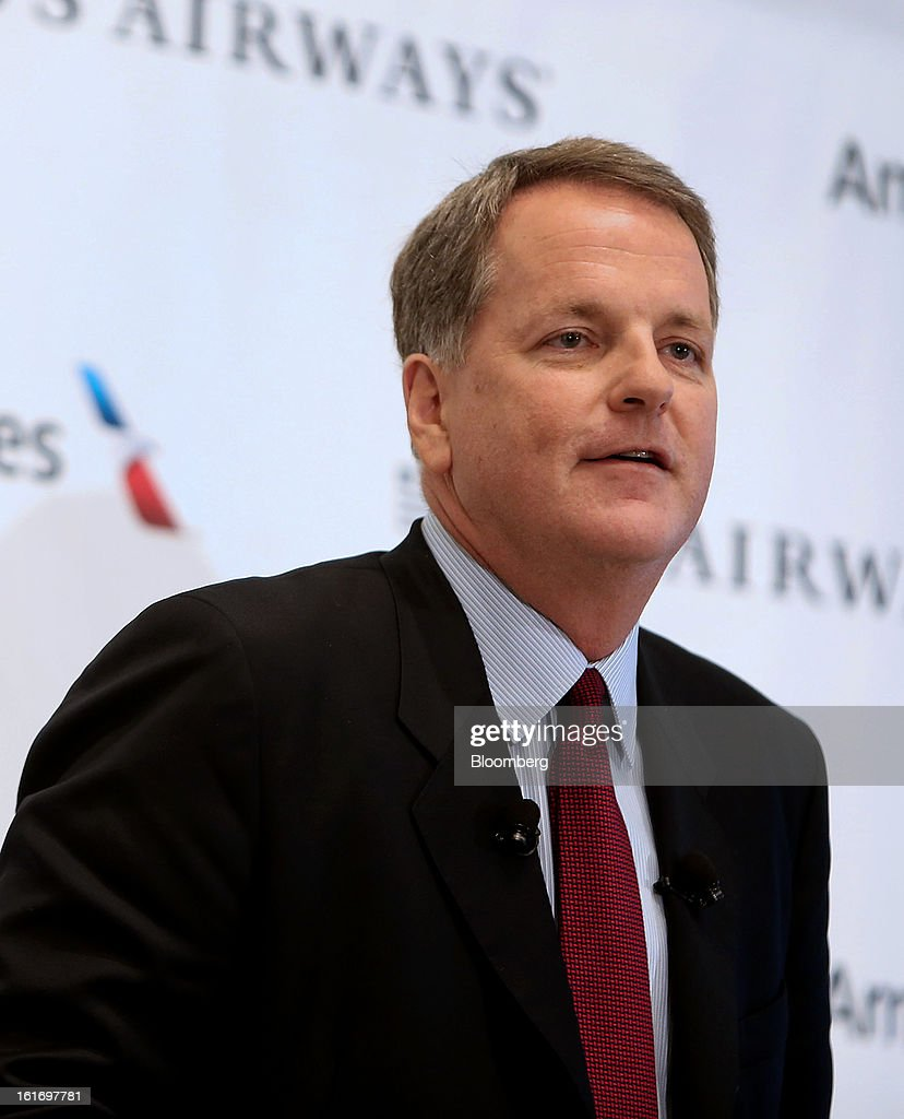 Doug Parker, chief executive officer of US Airways Group Inc., speaks during a press conference at Dallas Fort Worth Airport in Fort Worth, Texas, U.S., on Thursday, Feb. 14, 2013. US Airways Group Inc., spurned in three prior merger attempts, will combine with bankrupt AMR Corp.'s American Airlines in an $11 billion all-stock deal to create the world's largest carrier. Photographer: Mike Fuentes/Bloomberg via Getty Images