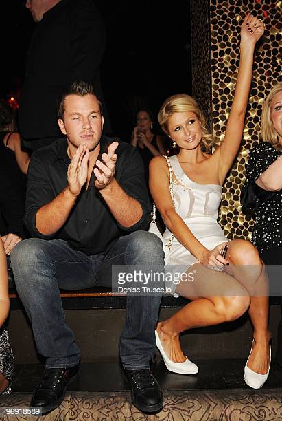 Doug Reinhardt and Paris Hilton attend TAO Nightclub at the Venetian on February 20 2010 in Las Vegas Nevada