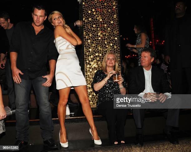 Doug Reinhardt Paris Hilton Kathy Hilton and Rick Hilton attend TAO Nightclub at the Venetian on February 20 2010 in Las Vegas Nevada