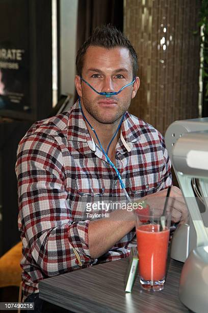 Doug Reinhardt takes oxygen at the launch of the new Trident Vitality gum at the Gansevoort Park Avenue on December 8 2010 in New York City