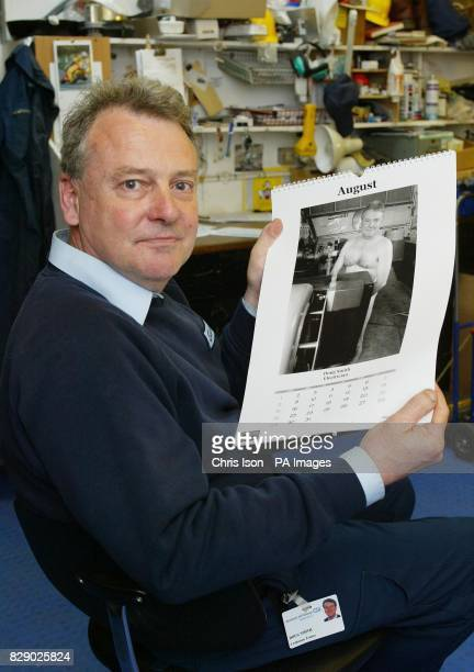Doug Smith looks at a picture of himself as Mr August in a charity calendar produced by the estate workers at Winchester's Royal Hampshire County...