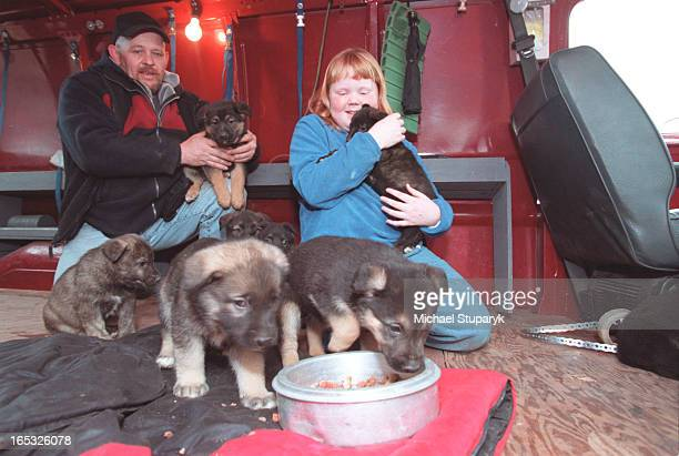 Doug Smith with daugter Robin10 with some of the 12 puppies from litter along with mother that were saved from this firethey are sitting in a vanalso...