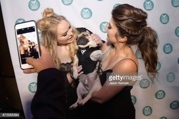 Doug the Pug and owner Leslie Mosier pose backstage at the The 9th Annual Shorty Awards on April 23 2017 in New York City