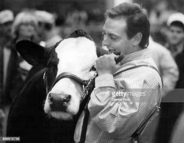 Doug Washam holds his Jr Grand Champ Steer 'Equalizer' Credit The Denver Post