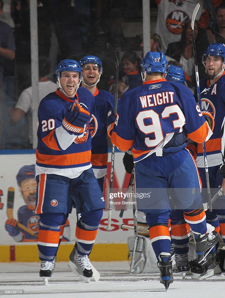 Doug Weight #93 and James Wisniewski #20 of the New York Islanders celebrate a goal at 17:21 of the third period against the Dallas Stars at the Nassau Coliseum on October 9, 2010 in Uniondale, New York. The Stars defeated the Islanders 5-4 in the shootout.