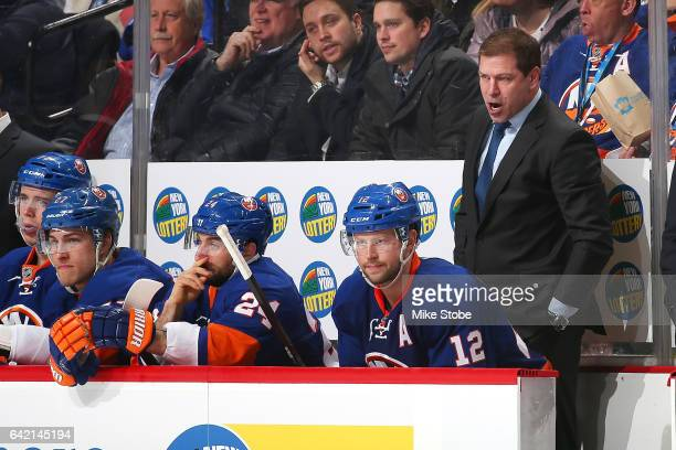 Doug Weight head coach of the New York Islanders looks on from the bench during the game against the New York Rangers at the Barclays Center on...