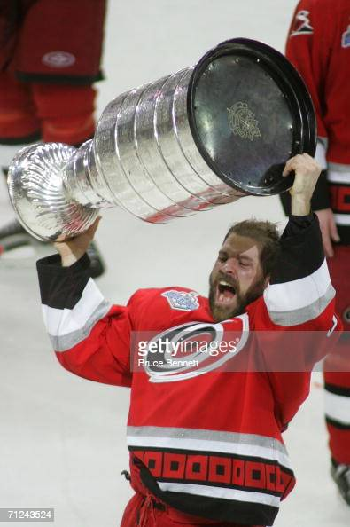 Doug Weight of the Carolina Hurricanes celebrates with the Stanley Cup after defeating the Edmonton Oilers in game seven of the 2006 NHL Stanley Cup...