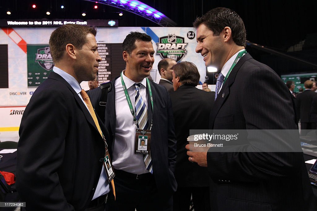 Doug Weight of the New York Islanders Bill Guerin of the Pittsburgh Penguins and Scott Lachance of the New Jersey Devils look on during day one of...