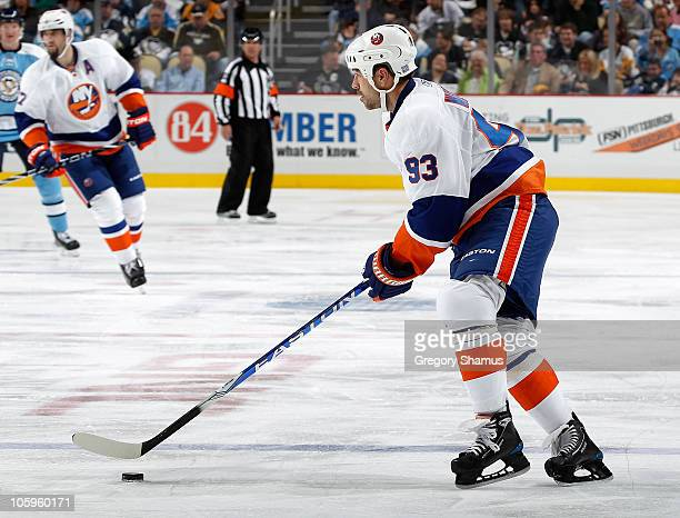 Doug Weight of the New York Islanders controls the puck against the Pittsburgh Penguins on October 15 2010 at Consol Energy Center in Pittsburgh...
