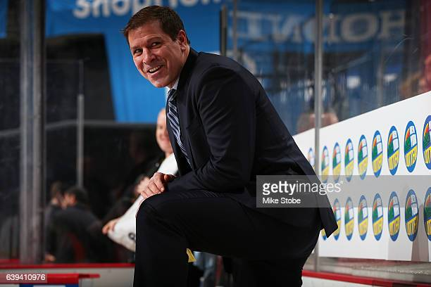 Doug Weight of the New York Islanders looks on from the bench during his first game as head coach against the Dallas Stars at the Barclays Center on...