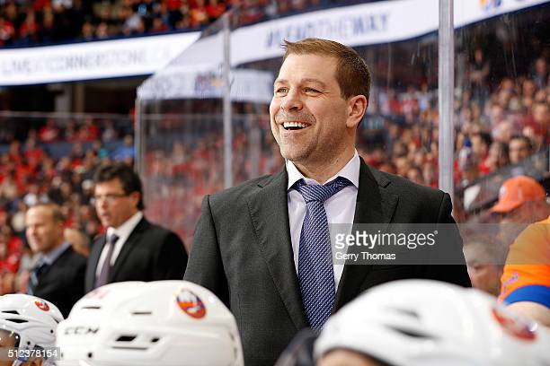 Doug Weight of the New York Islanders watches from the bench during an NHL game against the Calgary Flames at Scotiabank Saddledome on February 25...