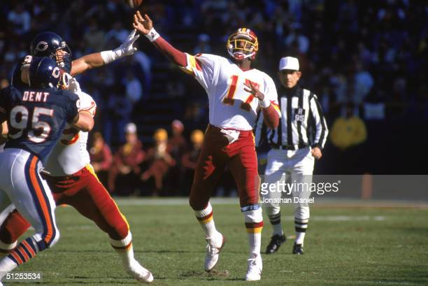 Doug Williams of the Washington Redskins passes during the 1988 NFL season game against the Chicago Bears at Soldier Stadium in Chicago Illinois The...