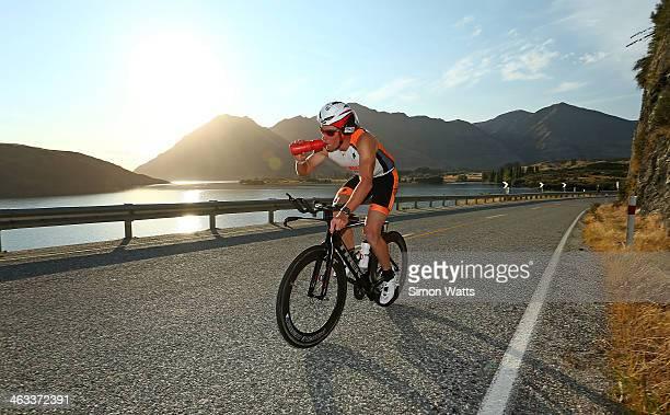 Dougal Allan of Wanaka rides along the Lake Wanaka waterfront during Challenge Wanaka on January 18 2014 in Wanaka New Zealand