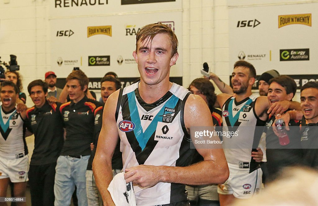 Dougal Howard of the Power sings the team song during the round six AFL match between the Richmond Tigers and the Port Adelaide Power at Melbourne Cricket Ground on April 30, 2016 in Melbourne, Australia.