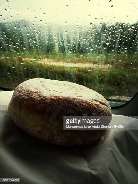 Doughnut In Car During Rain