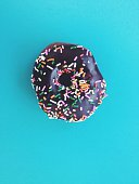 Doughnut With Chocolate Icing And Sprinkles