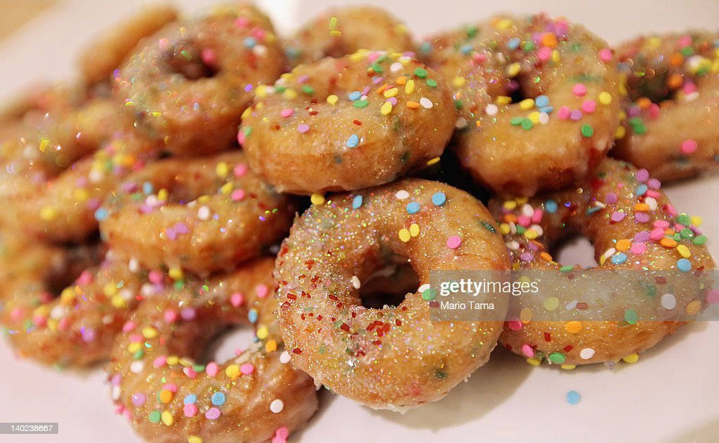 Doughnuts are displayed at a new gay resort hotel THE OUT NYC in midtown Manhattan after the ribboncutting ceremony on March 1 2012 in New York City...