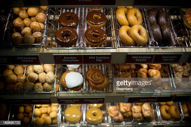 Doughnuts sit on display for sale at a Tim Hortons Inc restaurant in Oakville Ontario Canada on Monday Sept 16 2013 Tim Hortons Inc Chief Executive...
