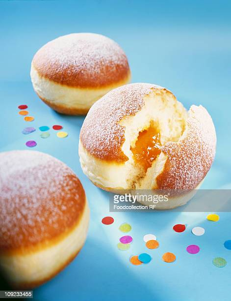 Doughnuts with confetti on blue background, close-up