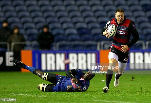 Dougie Fife of Edinburgh Rugby evades Loick Jammes of Grenoble during the European Rugby Challenge Cup match between Edinburgh Rugby and Grenoble at...