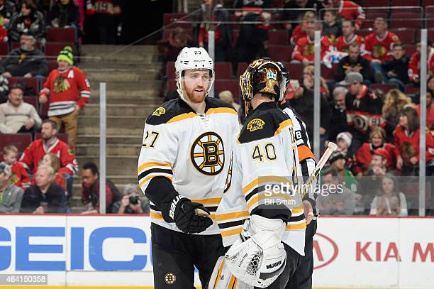 Dougie Hamilton and goalie Tuukka Rask of the Boston Bruins celebrate after defeating the Chicago Blackhawks 62 during the NHL game at the United...