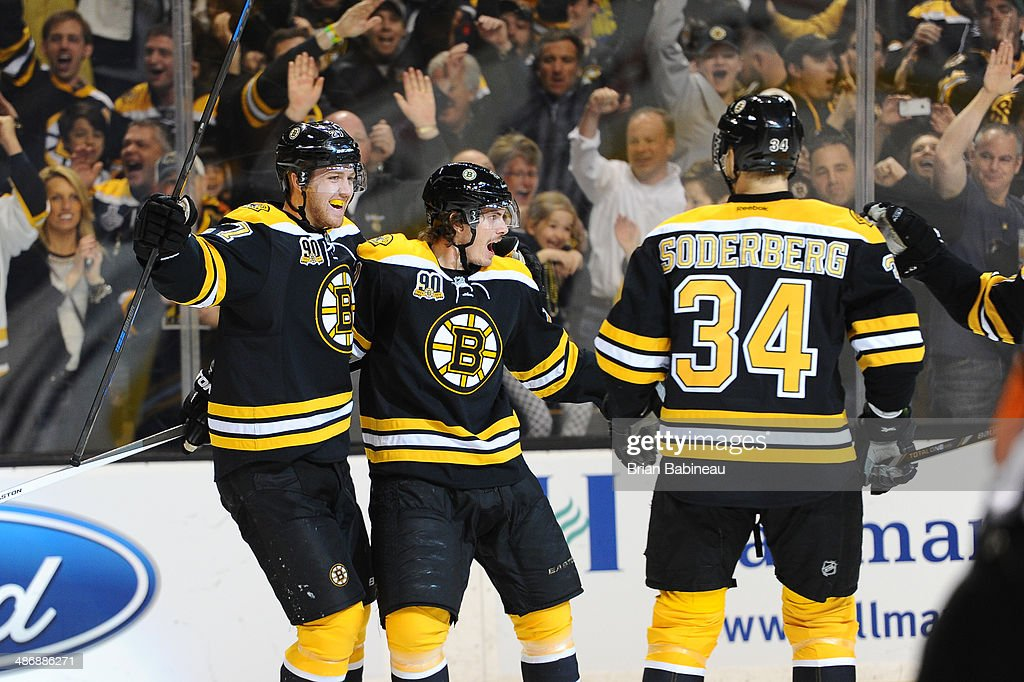 Dougie Hamilton #27 and Loui Eriksson #21 of the Boston Bruins all smiles after scoring a goal against the Detroit Red Wings in Game Five of the First Round of the 2014 Stanley Cup Playoffs at TD Garden on April 26, 2014 in Boston, Massachusetts.