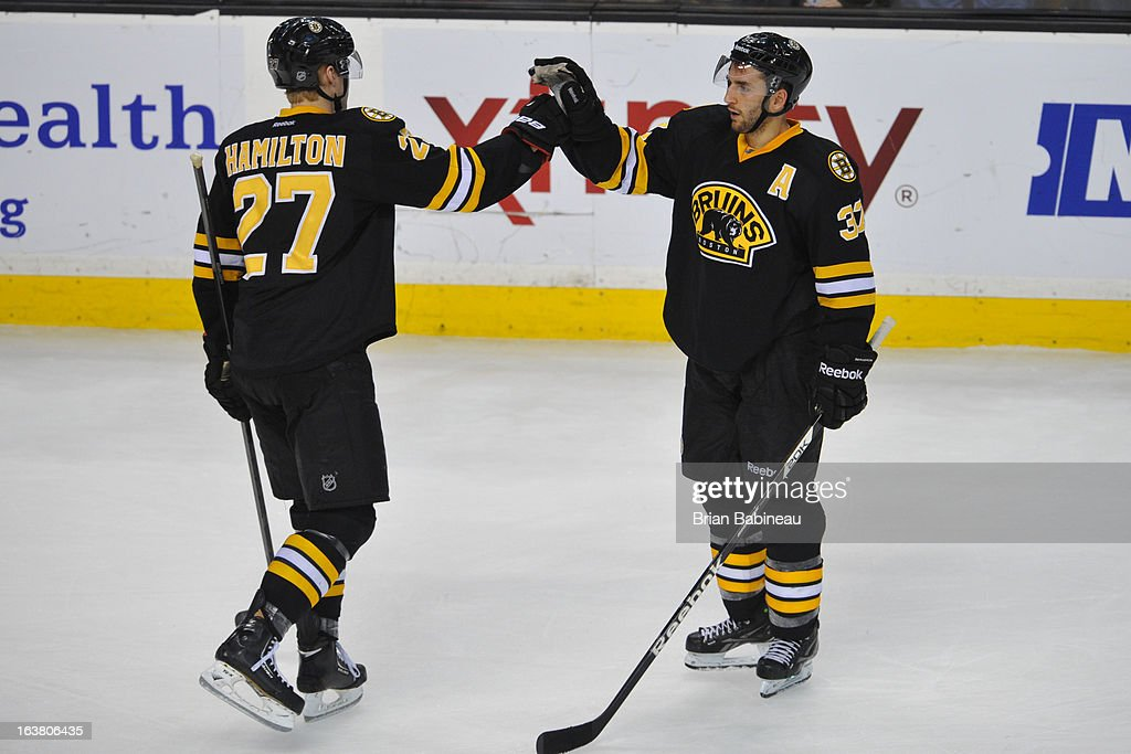 <a gi-track='captionPersonalityLinkClicked' href=/galleries/search?phrase=Dougie+Hamilton&family=editorial&specificpeople=6686524 ng-click='$event.stopPropagation()'>Dougie Hamilton</a> #27 and <a gi-track='captionPersonalityLinkClicked' href=/galleries/search?phrase=Patrice+Bergeron&family=editorial&specificpeople=204162 ng-click='$event.stopPropagation()'>Patrice Bergeron</a> #37 of the Boston Bruins high five after the win against the Washington Capitals at the TD Garden on March 16, 2013 in Boston, Massachusetts.