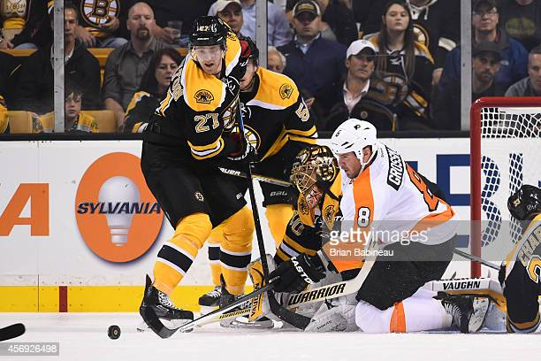 Dougie Hamilton and Tuukka Rask of the Boston Bruins watch the loose puck against Nicklas Grossmann of the Philadelphia Flyers during the season...