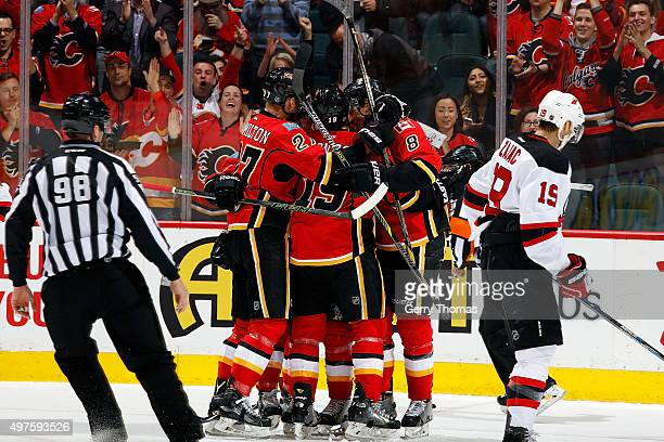 Dougie Hamilton David Jones and teammates of the Calgary Flames celebrate a goal against the New Jersey Devils during an NHL game at Scotiabank...