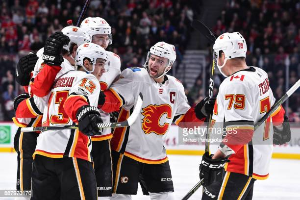 Dougie Hamilton Johnny Gaudreau Mark Giordano and Micheal Ferland of the Calgary Flames celebrate a first period goal by teammate Sean Monahan...