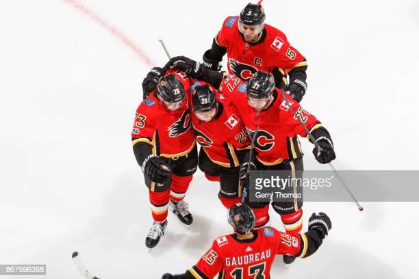 Dougie Hamilton Johnny Gaudreau Mark Giordano Sean Monahan and Curtis Lazar the Calgary Flames celebrate after scoring a second goal an NHL game...